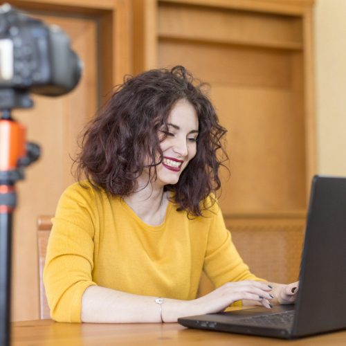 Young female blogger getting ready for a video chat.